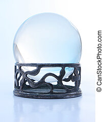 Blue crystal ball on stand