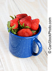 Blue Cup Full of Fresh Picked Ripe Strawberries