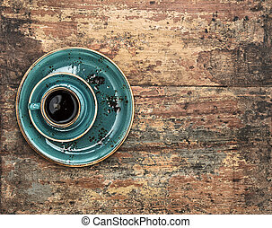 Blue cup of black coffee on wooden background