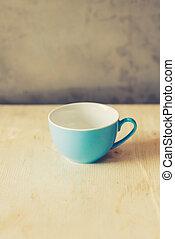 Blue cup of coffee in coffee shop vintage color tone
