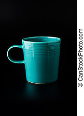 Blue cup of coffee on black background
