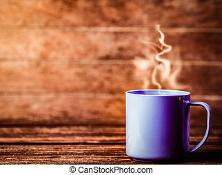 blue cup of coffee on wooden table