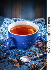 Blue cup with black tea