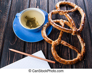 Blue cup with fresh pretzels