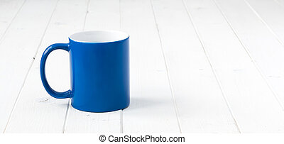 blue cup with white inside