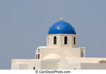 Blue cupola of a church in Santorini, Greece