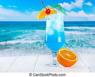 Blue Curacao cocktail on a beach