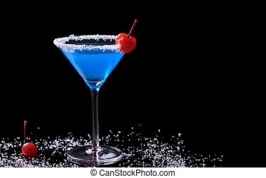 Blue Curacao drink in a glass with coconut flake rim and a maraschino cherry surrounded by coconut flakes and a maraschino cherry photographed on black (Selective Focus, Focus on the front of the glas