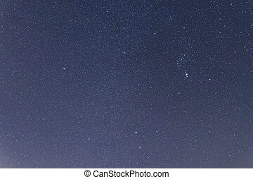 Blue dark night sky with many stars. Constellations Orion
