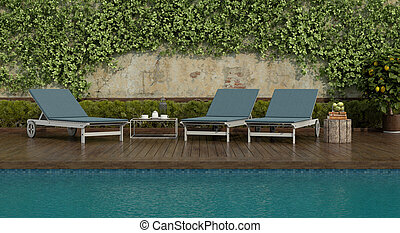 Blue deck chairs by the pool on a wooden floor
