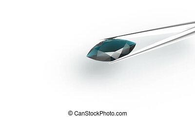 Blue diamond in tweezers - Blue diamond shape Marquis with...