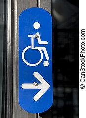 Blue Disabled Sign on Building Entrance