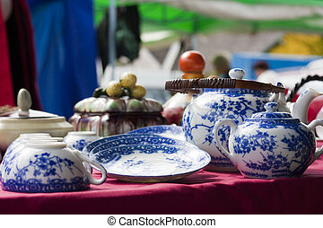 Blue dishware on flea market - Blue dishware with tea cup...