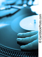 blue dj - scratch battle of dj playing on his vinyls hand on