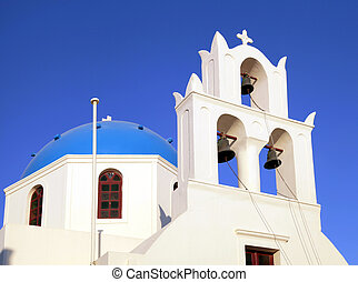 Blue dome greek orthodox church and belltower, Santorini, Greece
