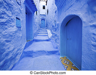 Blue door in Blue city Chefchaouen. View from the medina of...