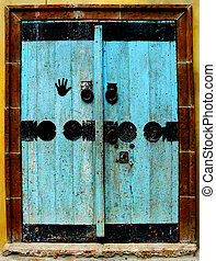 Blue door - Old wooden door painted light blue with black...