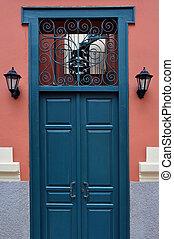 blue door with antique iron pattern