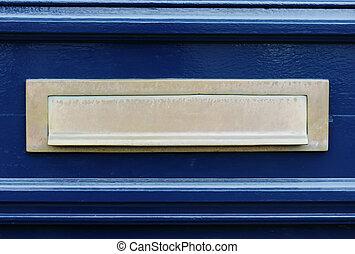 Blue door with letterslot / mailbox - Detail of a blue door...