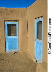 Blue doors - Taos Pueblo houses in New Mexico, USA