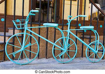 Blue double bike near cafe