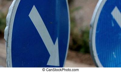 Blue down arrow sign
