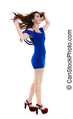 Blue dress woman smile  and the wind blowing hair