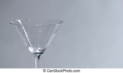 Blue drink into martini glass