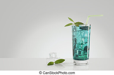 Blue drink with ice cubes and mint leaves on white background