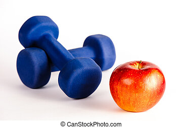 Blue dumbbells and red apple isolated on a white background