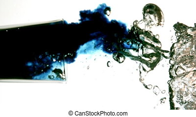 Blue dye moving in water on white background in slow motion