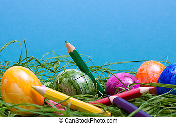 blue easter background with eggs and pencils