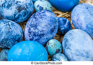 Blue Easter eggs close-up, selective focus, shallow depth of field.