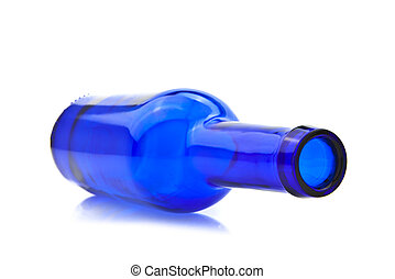 Blue empty bottle laying on side Isolated on white ...