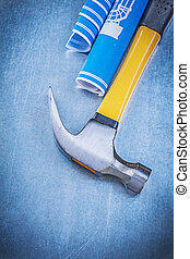 Blue engineering drawings claw hammer on metallic background