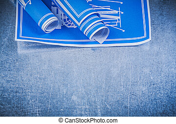 Blue engineering drawings on metallic background maintenance con