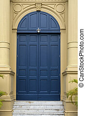 blue entrance door in front of residential house