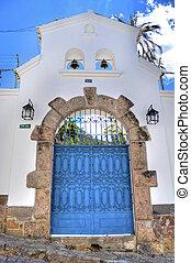 Blue entrance door with bells