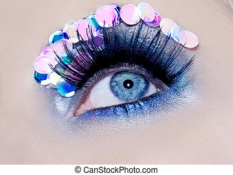 Blue eye macro closeup makeup sequins colorful fashion...