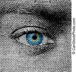 Blue eye on canvas background