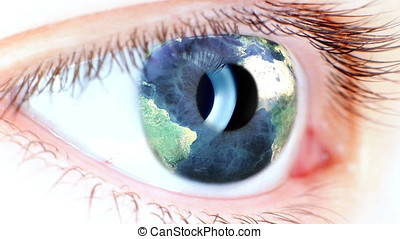 Blue eye with Earth map rotating on iris