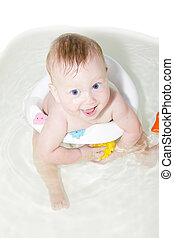 Blue-eyed Baby swimming in the bath room