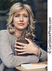 Blue eyed blond beauty thinking