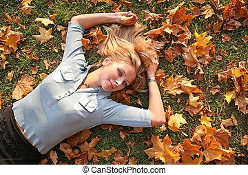 blue-eyed blond lies among yellow leaves 3