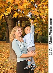 blue-eyed blond with the son in the park in autumn