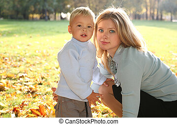 blue-eyed blond with the son in the park