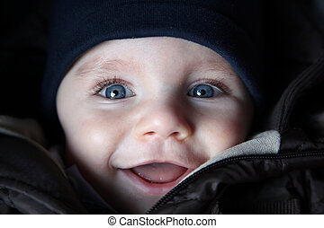 cute little newborn baby with big blue eyes