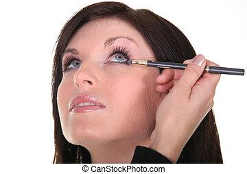 blue-eyed brunette being made up