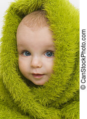 Blue Eyed in Green III - A blue eyed baby wrapped in a furry...