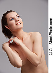 Blue-eyed naked woman with healthy skin